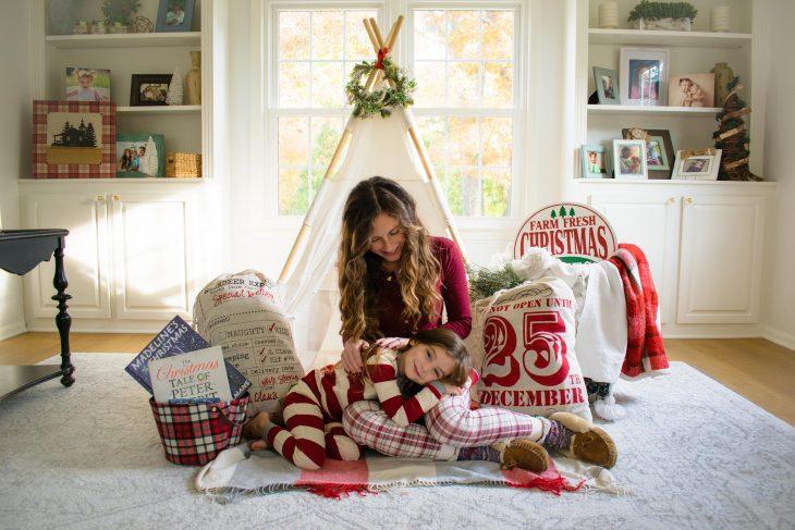 Mom and Daughter Christmas Pajamas in Christmas Setting
