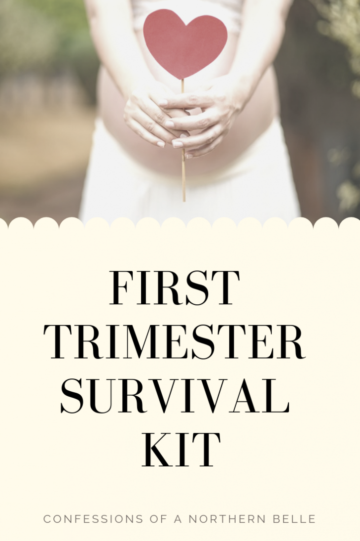 Pregnant Woman holding a Heart on a Stick in front of her belly and text reading First Trimester Survival Kit