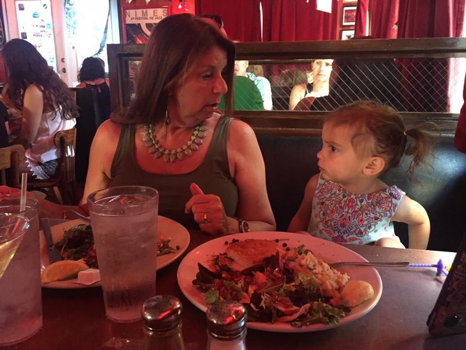 Woman and Toddler at Red Bar