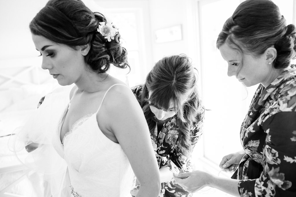 Maid of Honor Helping Bustle Brides Dress