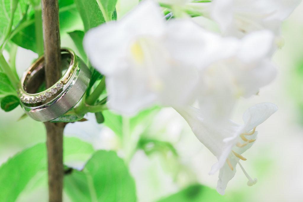 Wedding Rings on White Flower