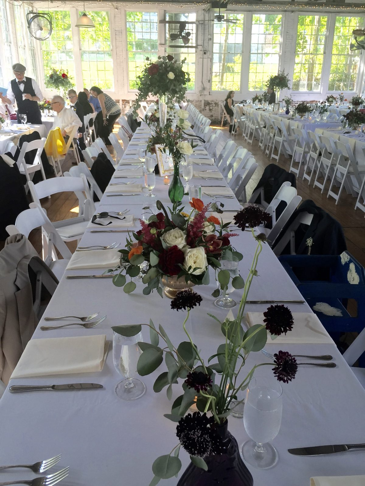 Family Style Tables at Wedding with Fresh Flowers and Vintage Glass Vases