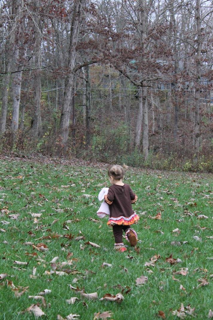 Little Girl Running Outside during Fall in the South with No signs of Foliage