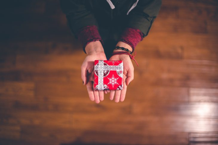 Woman holding small gift box in hands