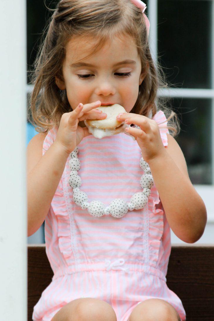 Little girl eating ice cream cake sandwich