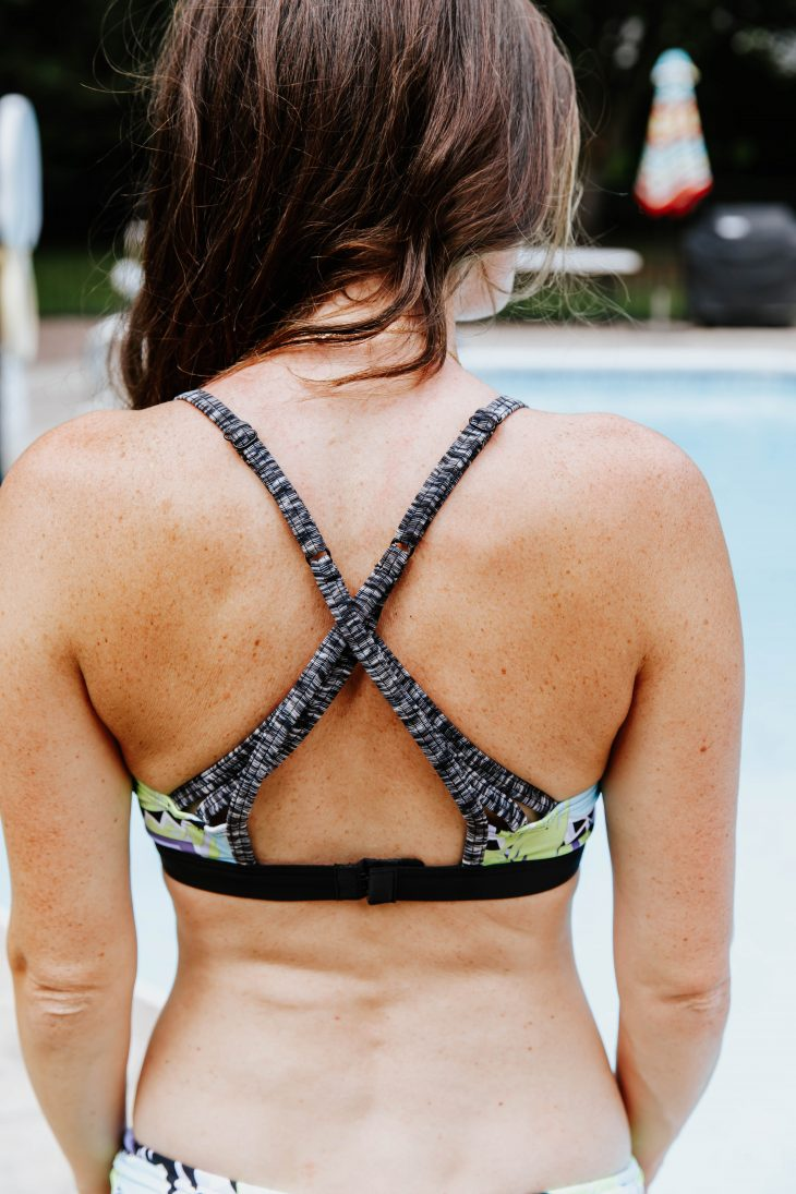 womans freckly skin in bathing suit