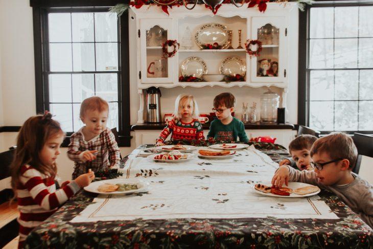 Kids in Christmas pajamas eating santa pancakes