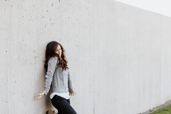 fashion blogger making awkward face pressed against the wall