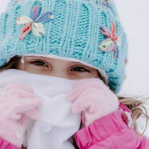 Little Girl Wearing Blue Winter Hat Pink Gloves and White Face Neck Wrap