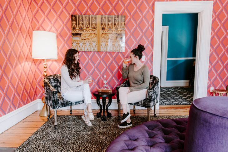 Purpose as a Blogger - Build a Community - Pink room with purple and teal furniture girls drinking rose