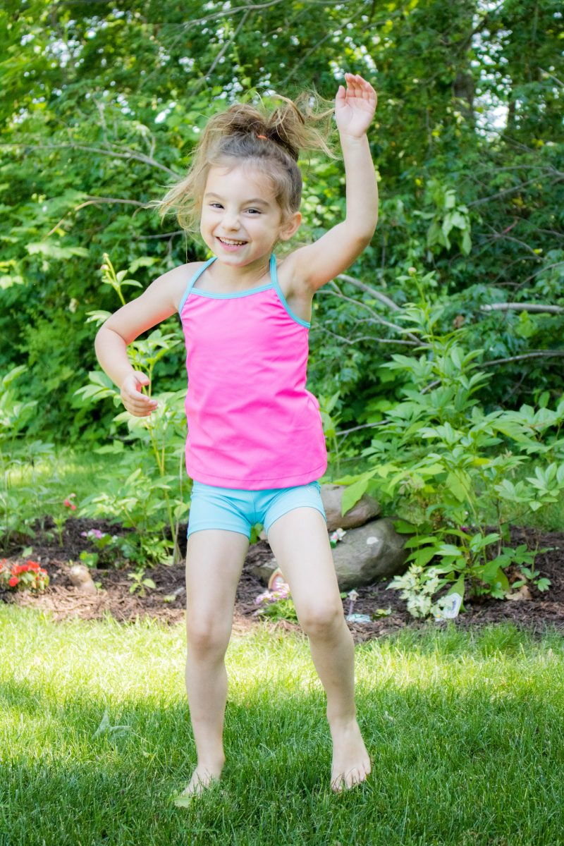 Dancing toddler in bike shorts and matching tank by Lucky and Me