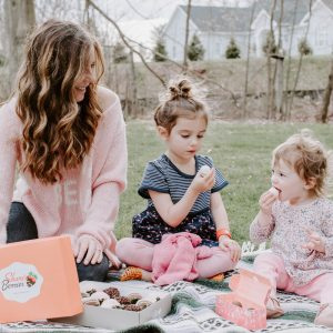 Mom and Daughters eating chocolate covered strawberries