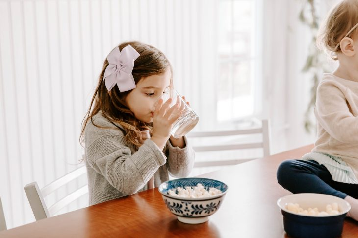 Toddler Drinking Water and Eating Popcorn