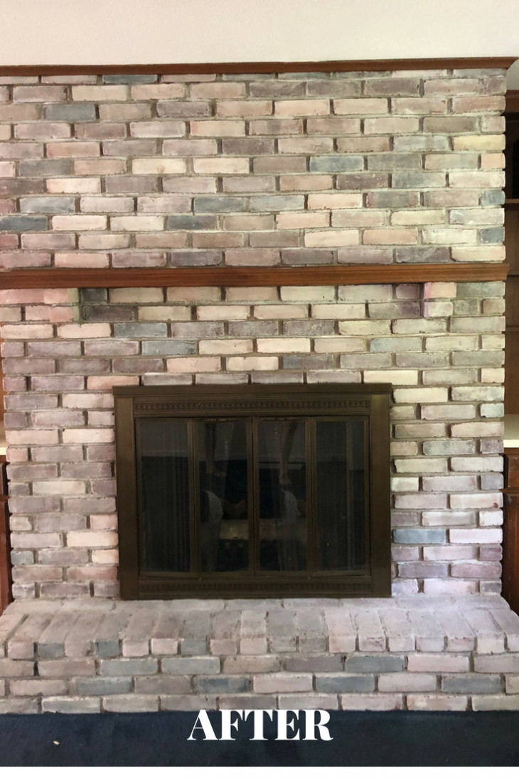 whitewash fireplace with brown wood molding