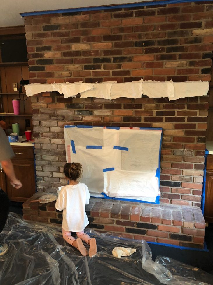 brick fireplace taped for whitewash