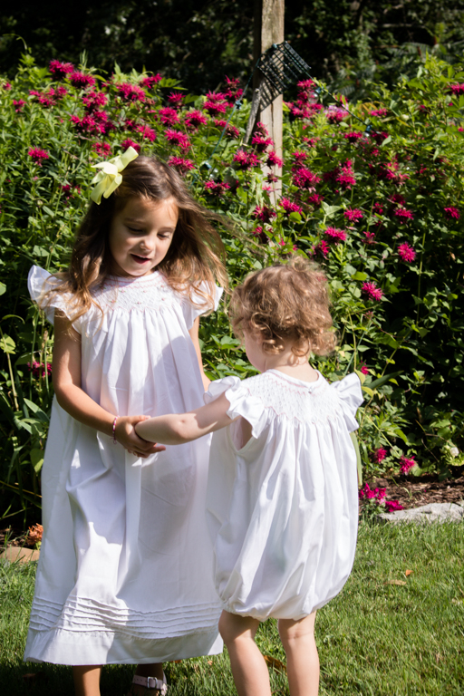 Girls Holding Hands in Garden Dancing