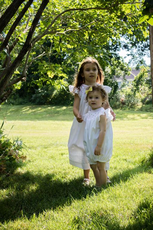 Little girls in white dresses