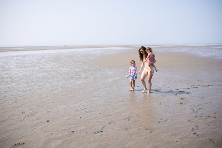 Mom and Daughters walking on the beach