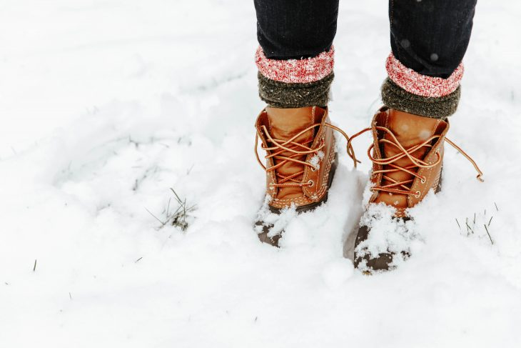 LL Bean Boots with Red and Gray Camp Socks Standing in the Snow
