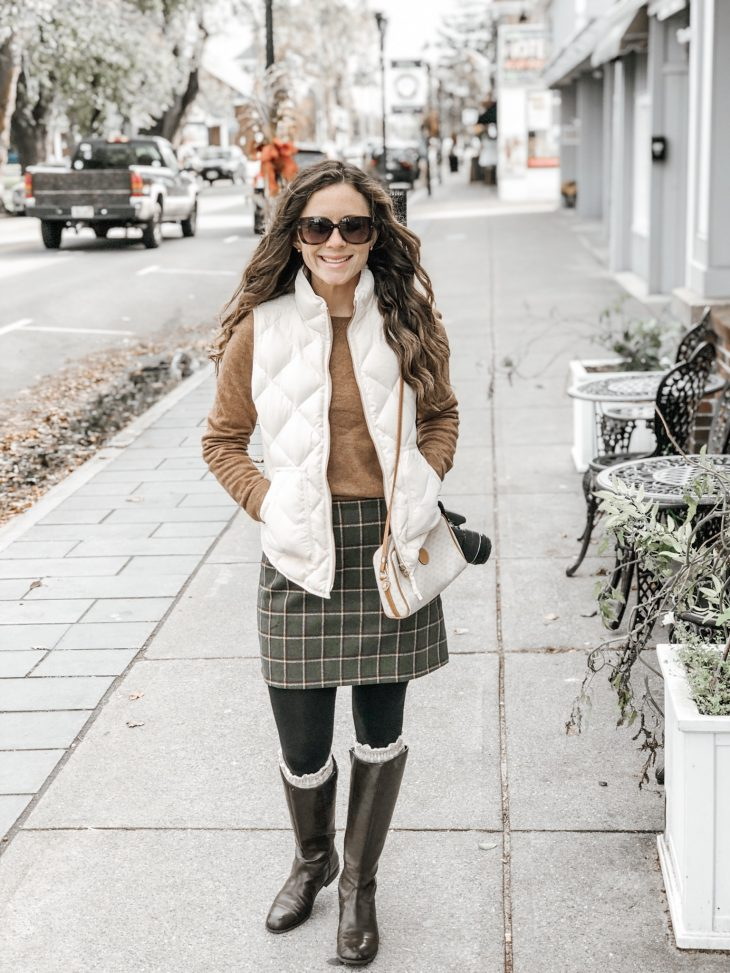 JCrew puffer vest, sweater, plaid skirt, tights, knee high boot socks, and riding boots
