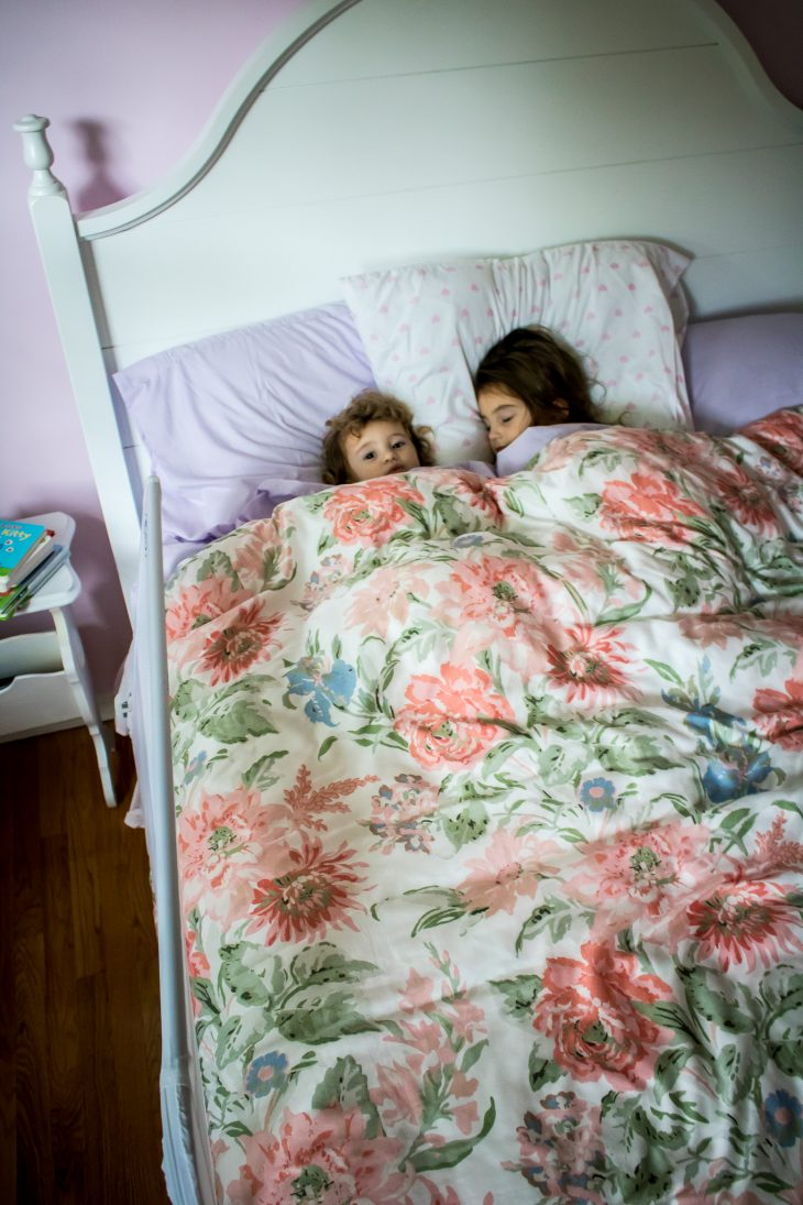 Sisters Sleeping in Queen Size Bed