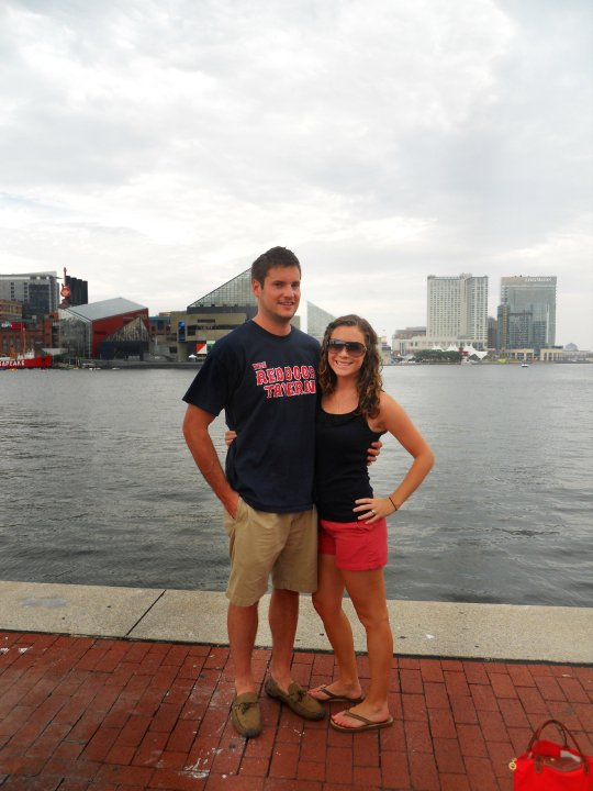 Couple standing in Baltimore Harbor