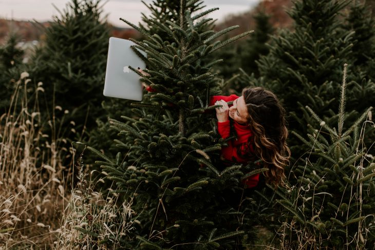 Woman behind Christmas Tree wearing Dudley Stephens