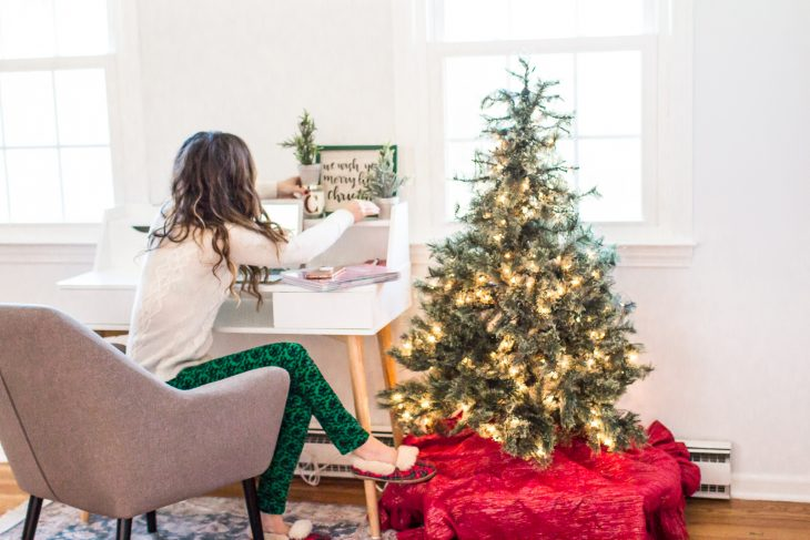 Adjusting Christmas Decorations in Home Office