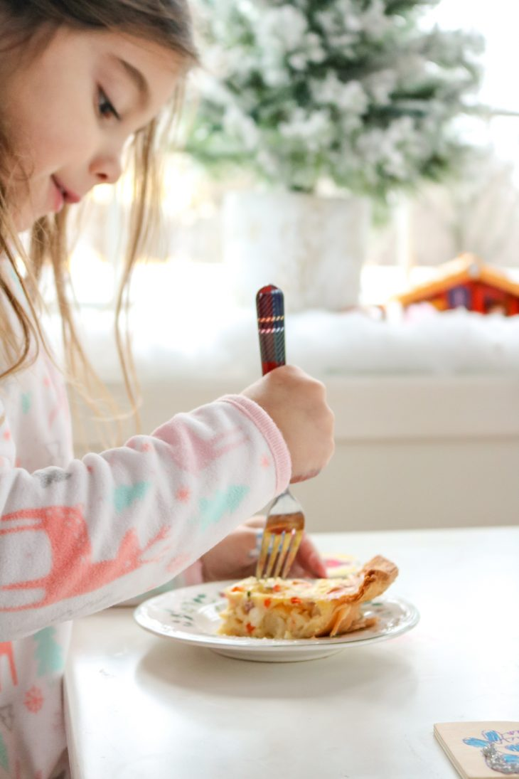 Little girl eating quiche