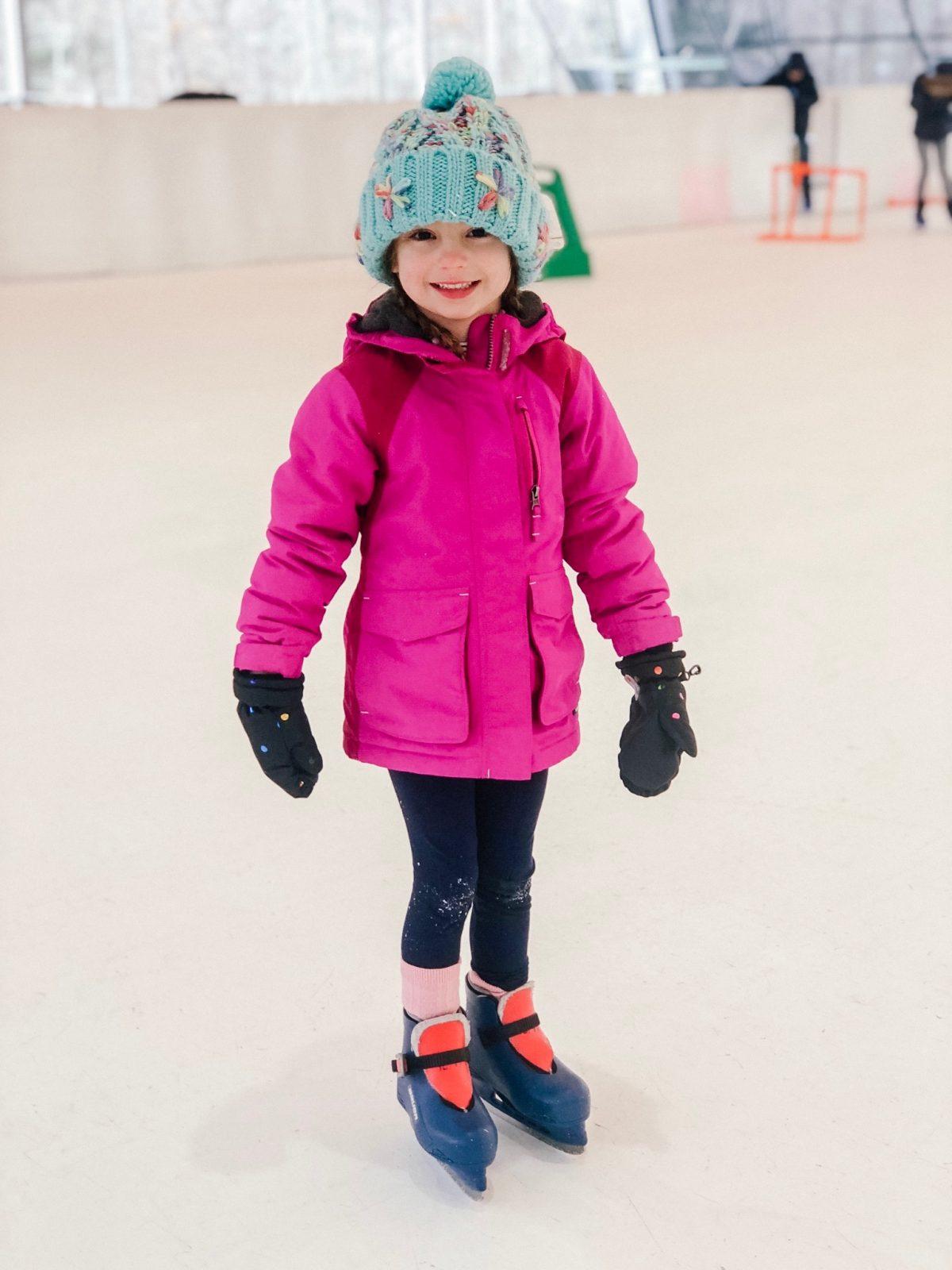 Little Girl wearing ice skates Woodloch Pines Resort in Pocono Mountains