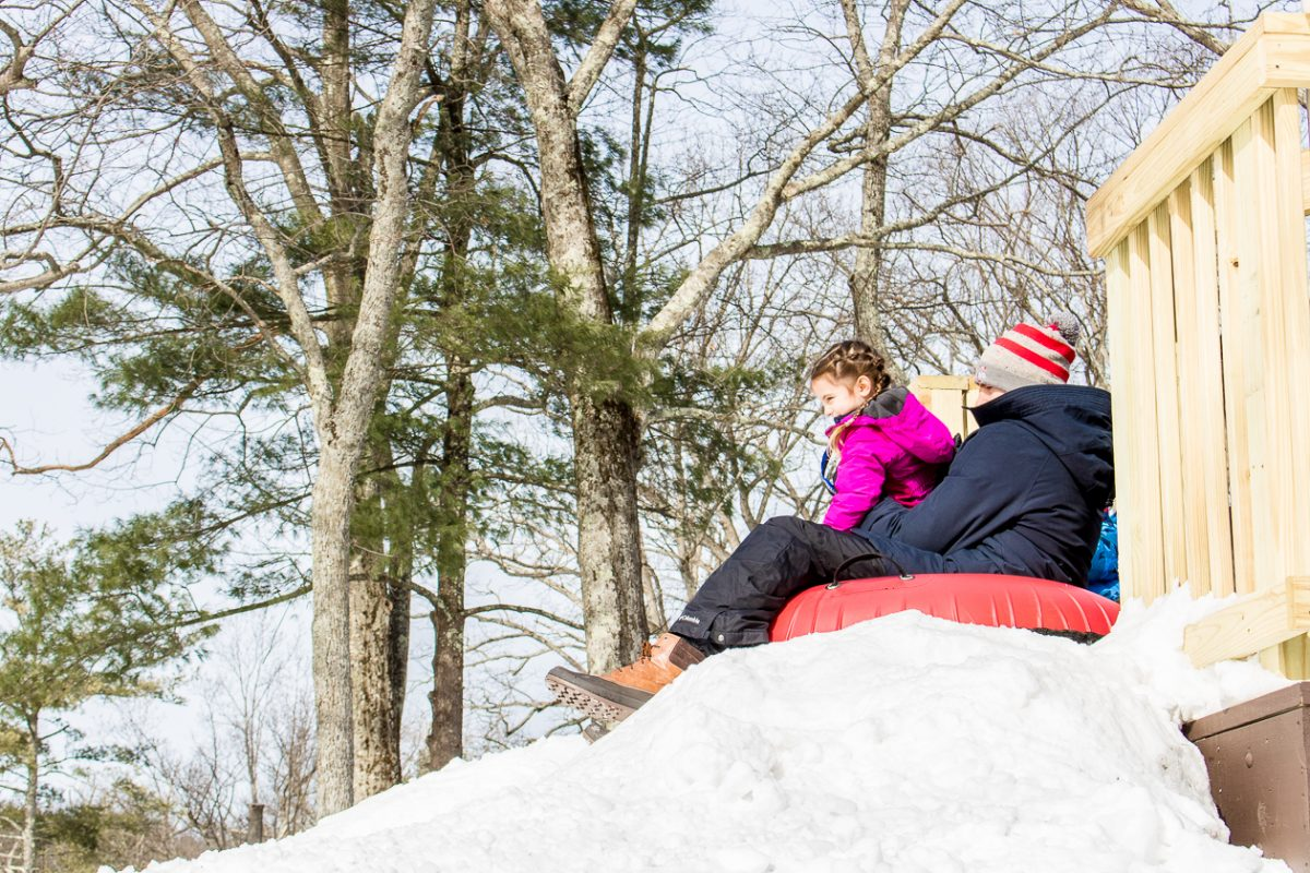 Dad and daughter about to go tubing Woodloch Pines Resort in Pocono Mountains