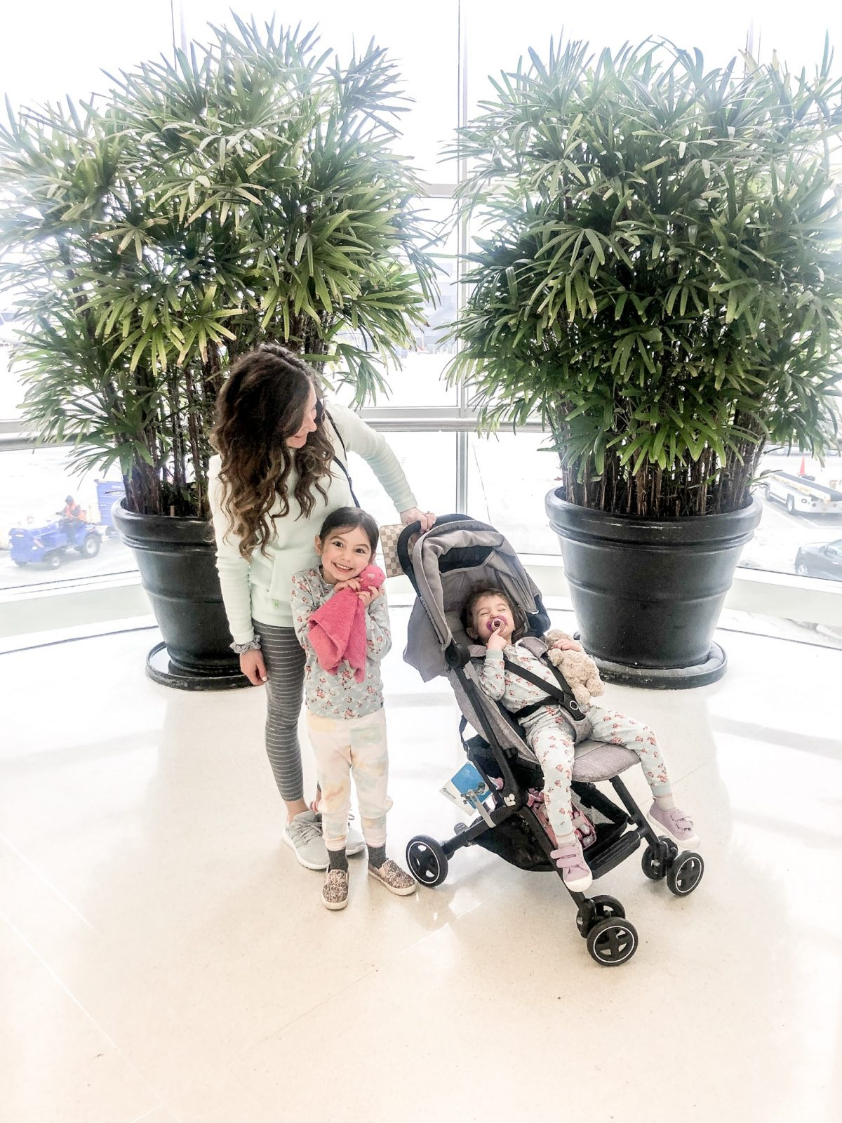 Mom alone at airport with toddlers
