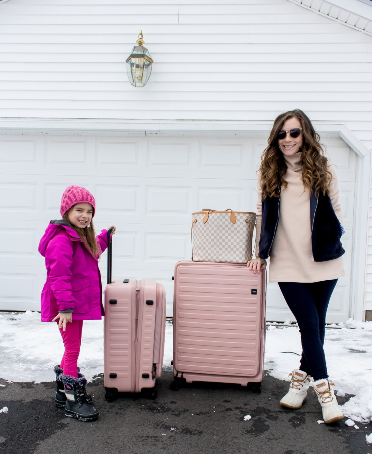 Mom and her Daughter with Suitcases