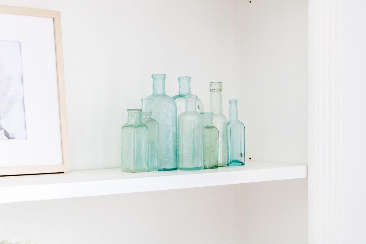 Blue glass bottles grouped on a shelf