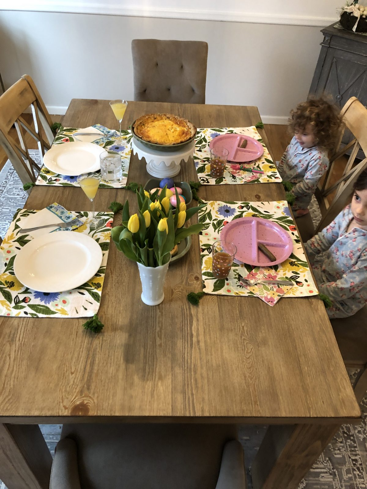 Easter Brunch Table set with flowers and a quiche