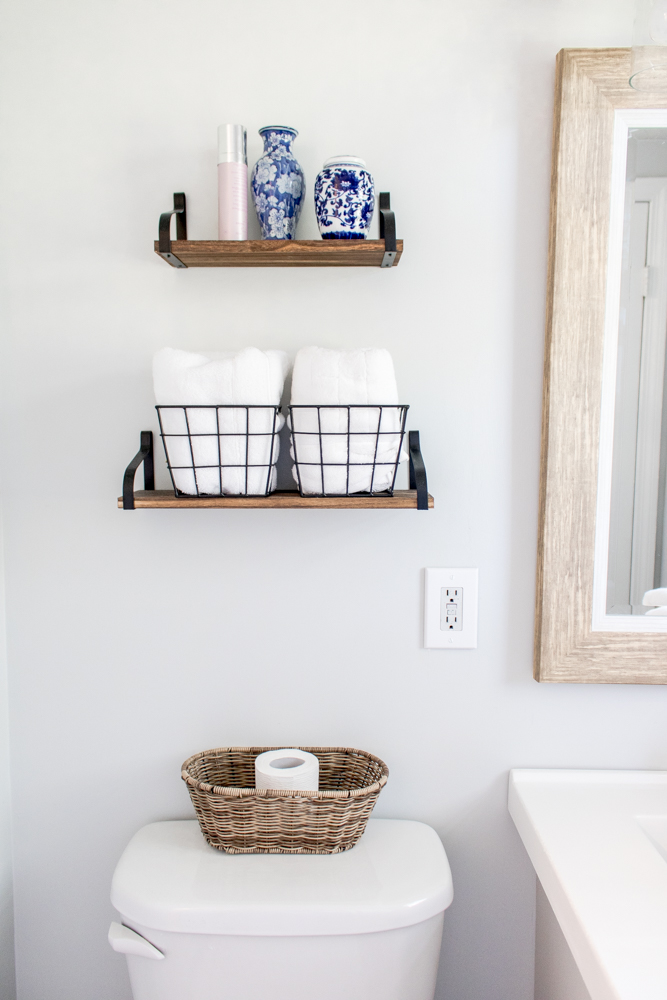 Small Bathroom Renovation Gray Paint Wire Baskets Floating Shelves