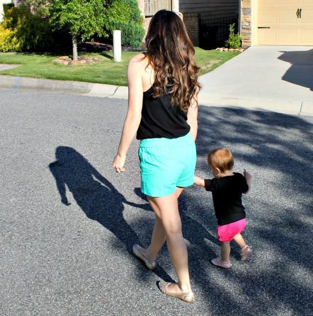 Mom walking in the street with her daughter
