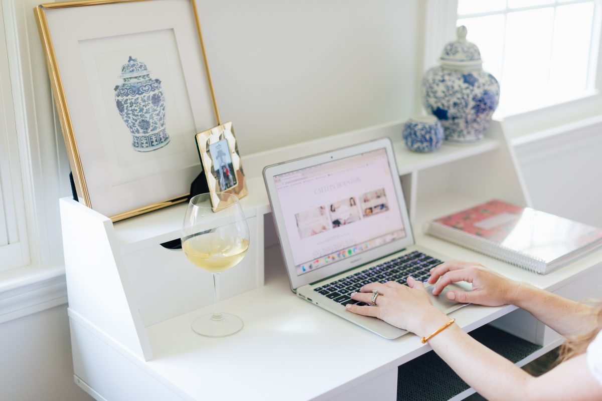 Blogger Typing at Her Computer on a White Desk