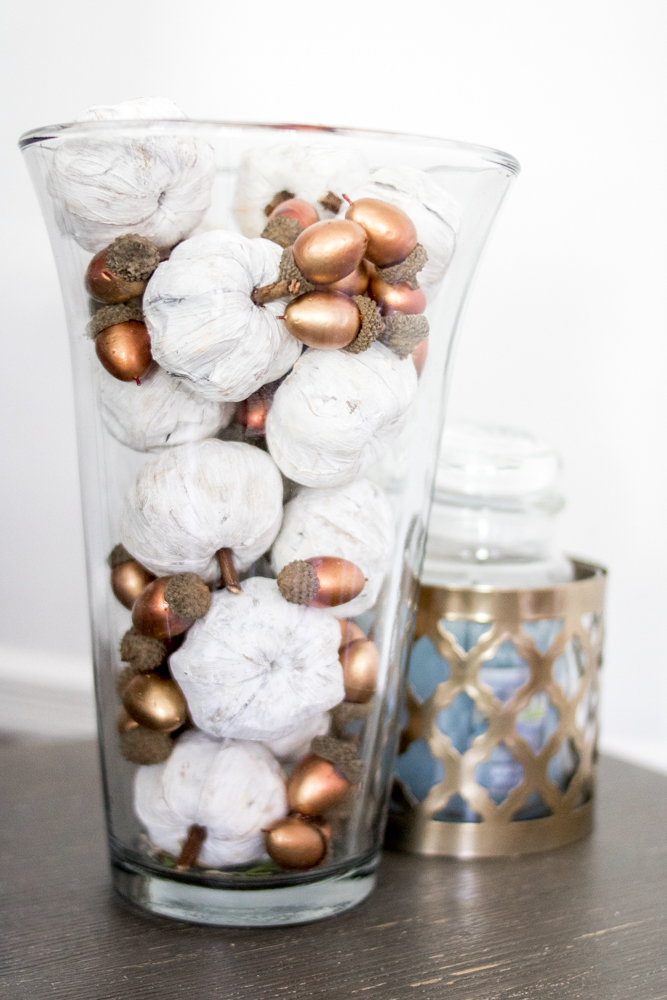 Hurricane Vase filled with Pumpkins and Acorns