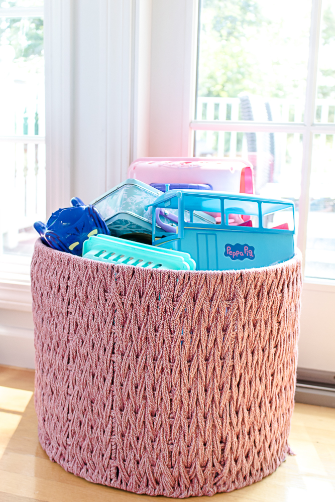 Pink rope basket filled with toys