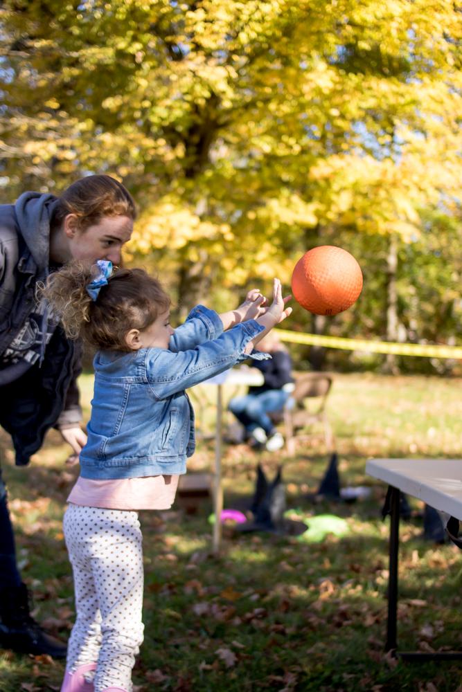 Little girl throwing ball