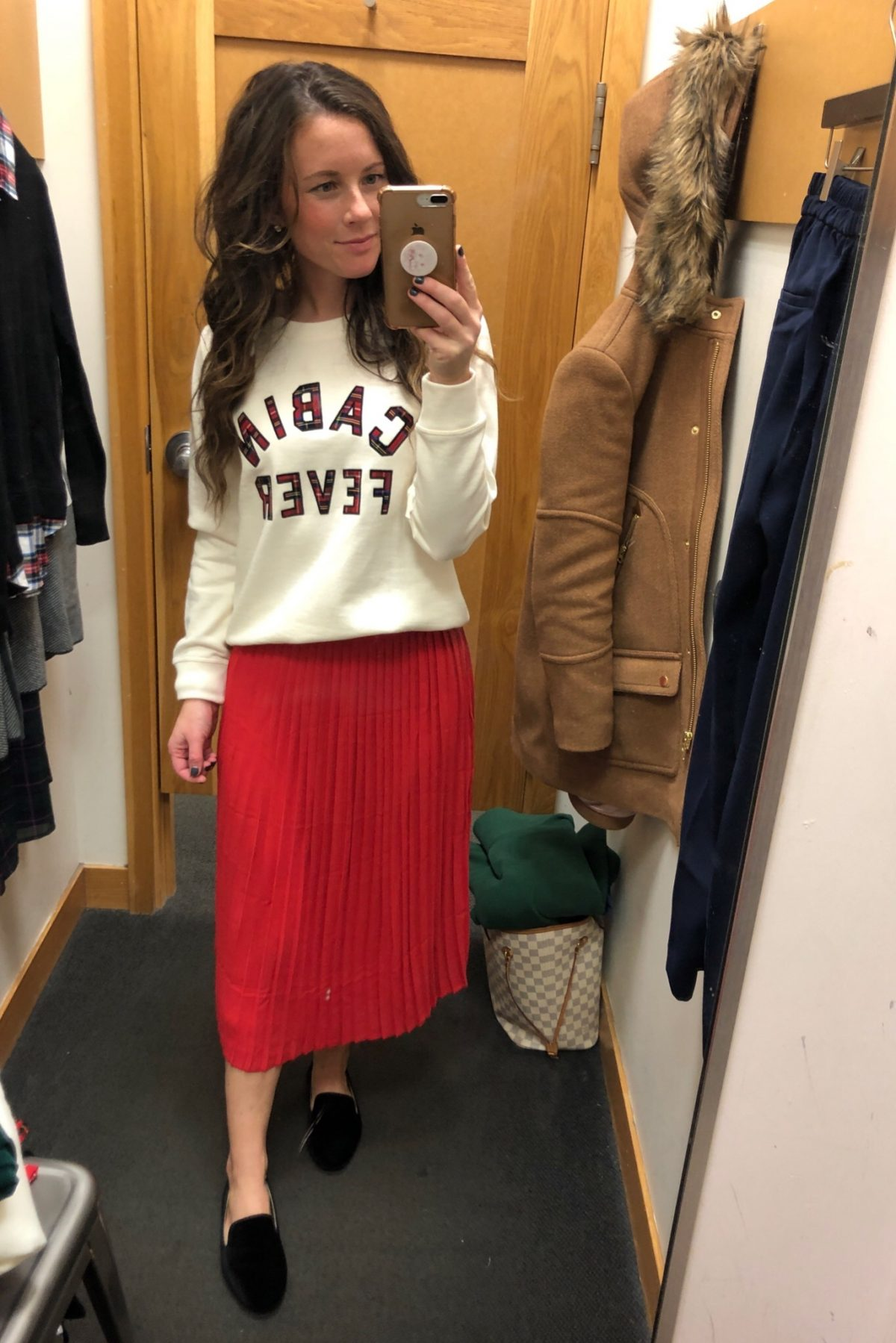 Red pleated skirt and Cabin Fever sweatshirt