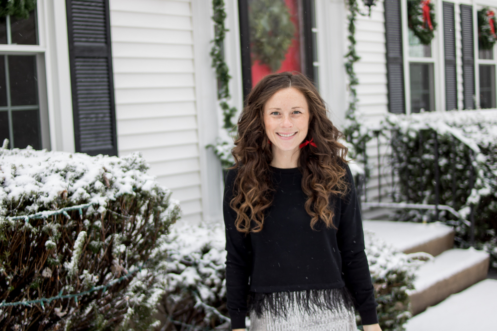 woman wearing black top smiling outside in snow botox