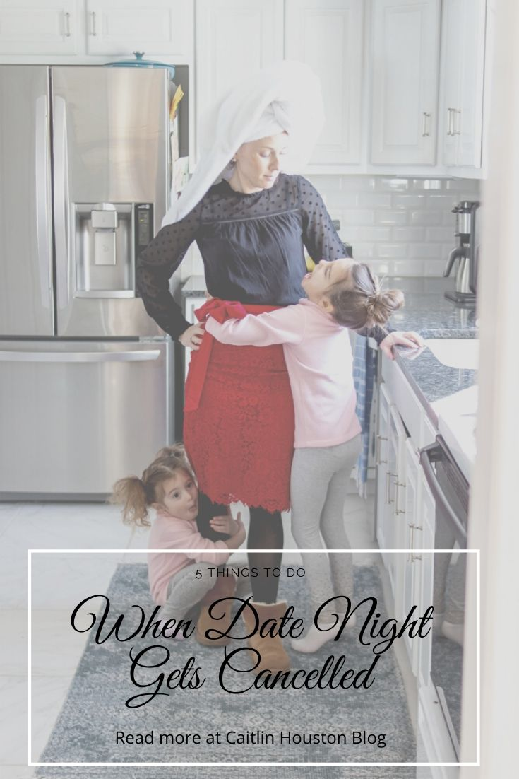 mom with towel in hair and date night outfit with kids hanging off of her