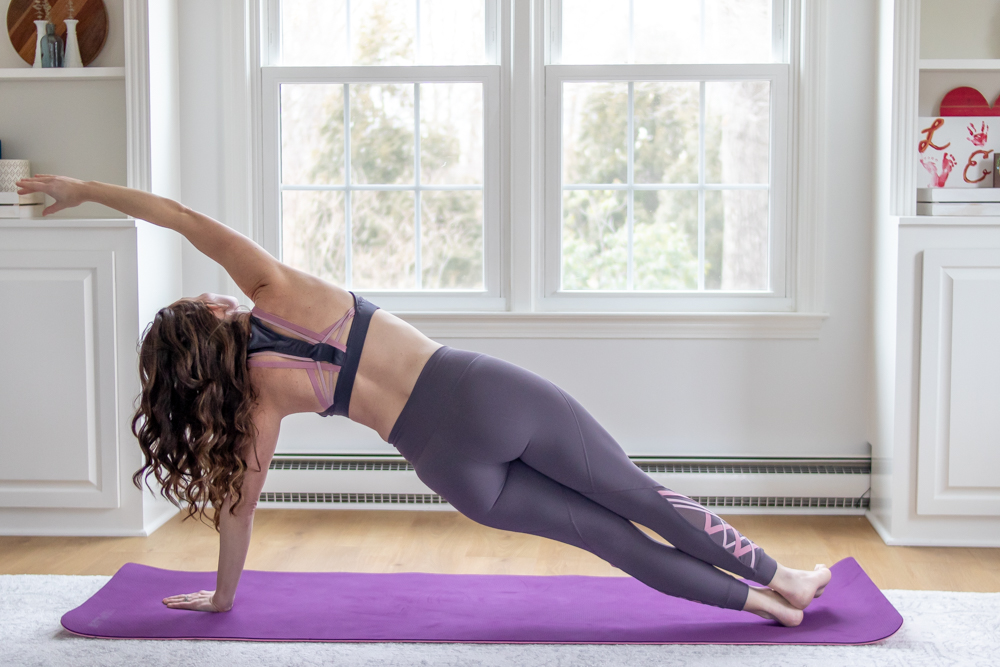 woman doing side plank in yoga