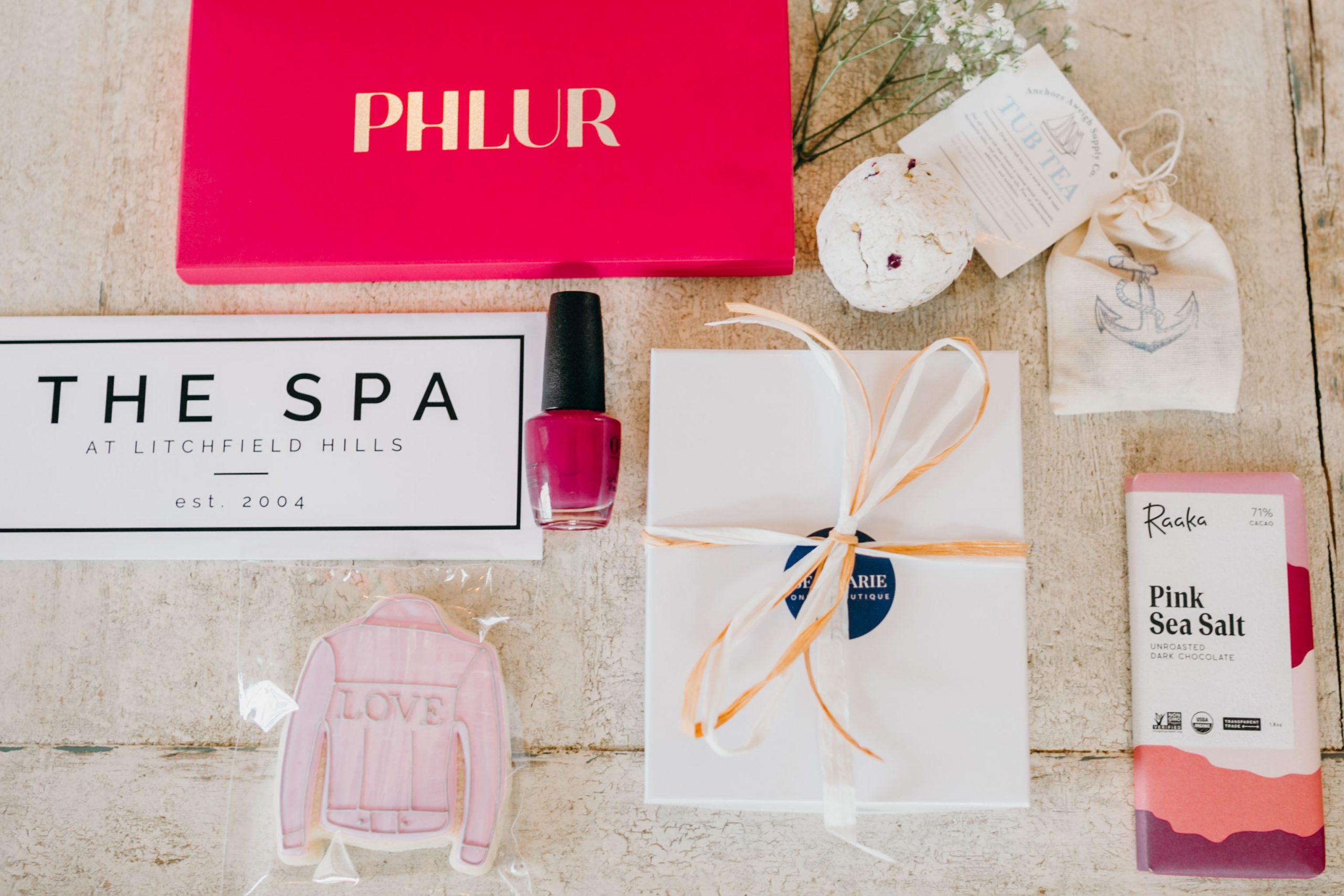 Phlur perfume, tub tea, homemade bath bomb, seamarie designs earrings, raaka chocolate, love jacket cookie, the spa at litchfield hills
