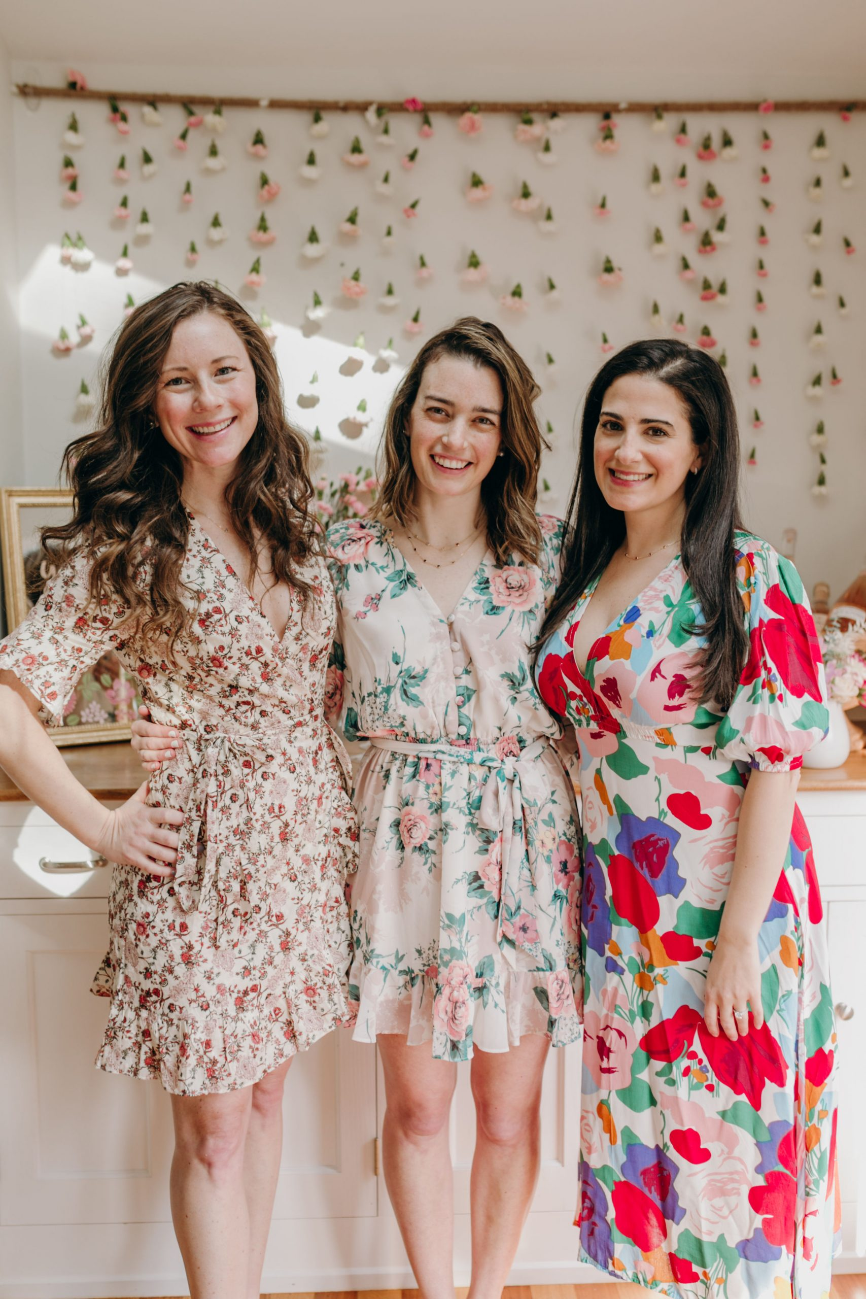 three women in floral dresses at brunch