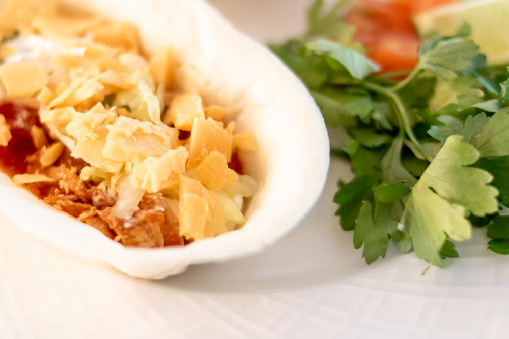 Shredded Chicken tacos in burrito bowl with cilantro