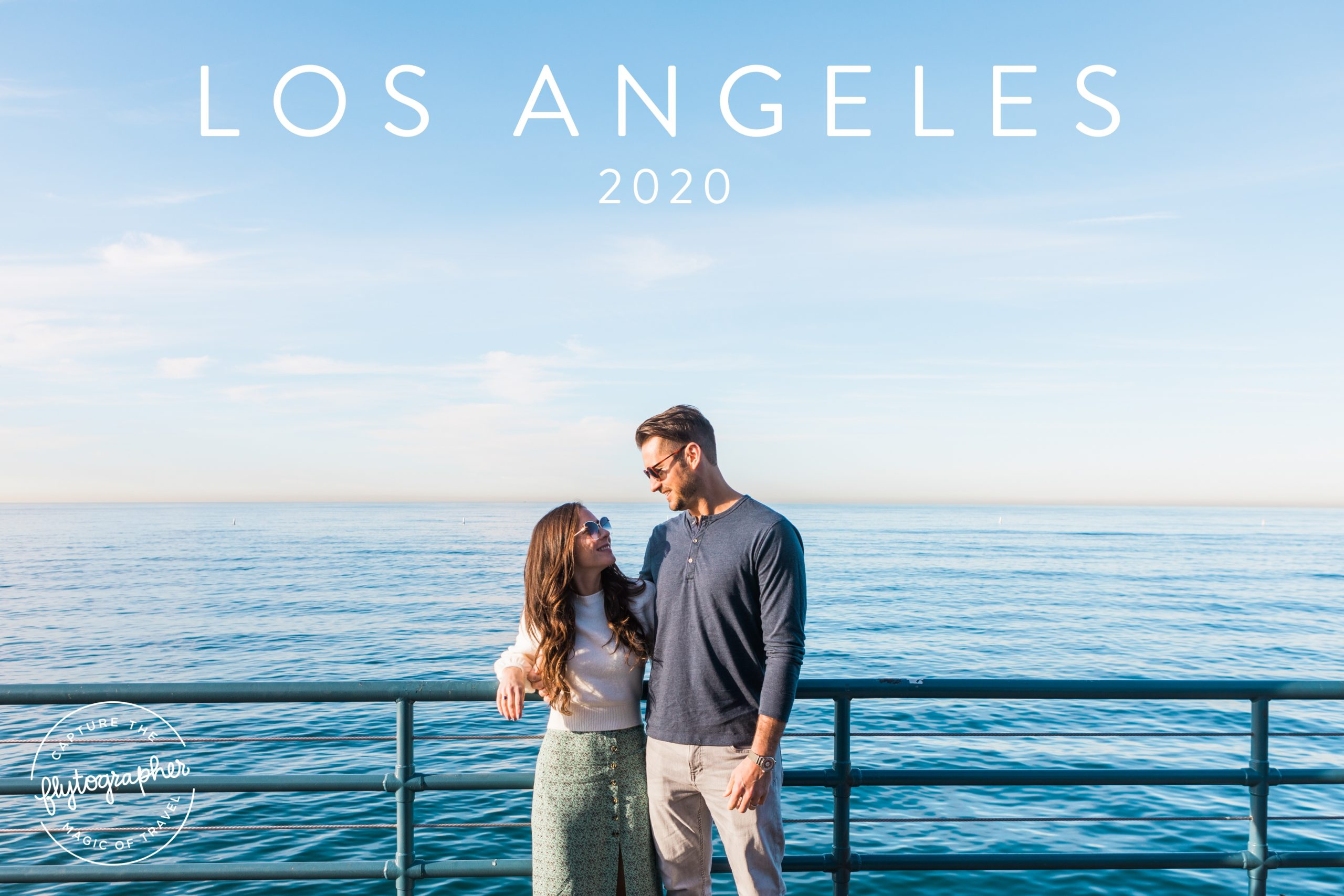 Couple smiling at one another in Los Angeles on Santa Monica Pier