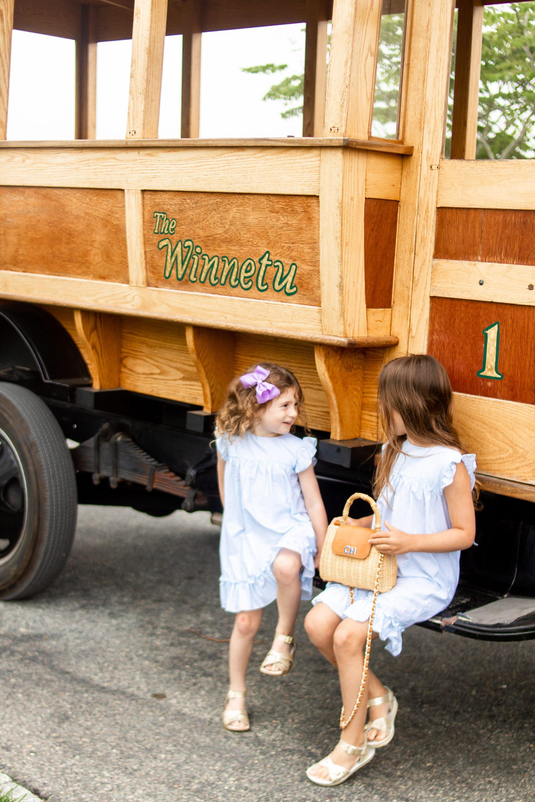 little girls sitting on antique car at Winnetu